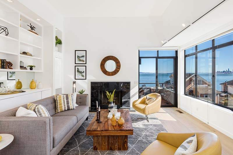 Living room with fireplace and view