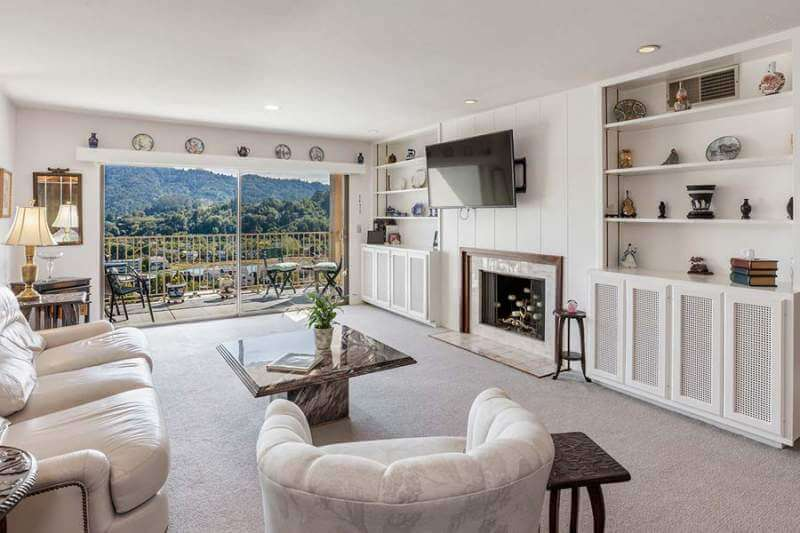 Living room with fireplace and cabinets| 565 Via Casitas #32, Greenbrae, CA